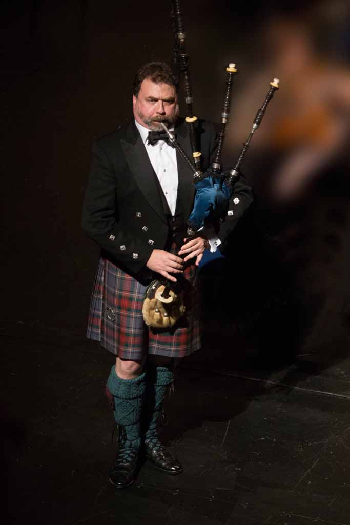 Tyrone Heade, performing with the Yakima Symphony Orchestra, 2014. Tyrone is pictured performing with is Grandfather's bagpipe, ca 1900, made by R.G. Lawrie. For this performance, Tyrone set the pipe to concert pitch (A440), a process that took 26 hours. It was the first time the instrument was performed with it's original chanter since Tyrone was 12 yrs old.