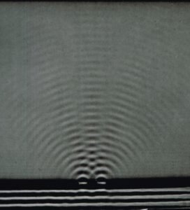 """Bagpipe sound depiction thru Water wave pic, Education Development Center negative, """"Arons"""", #RT55, ca 1960."""