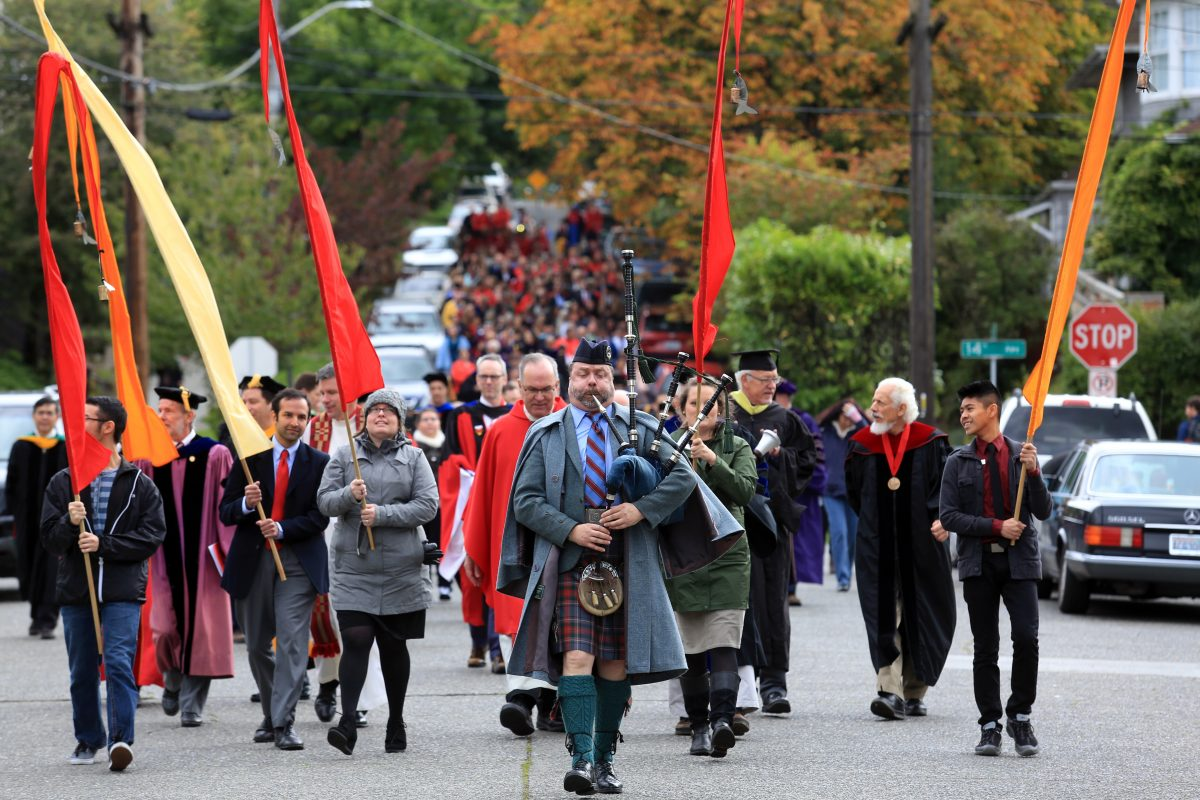 Cathedral Piper Tyrone Heade leads the mile-long annual procession, officially opening studies at Seattle University, Seattle.