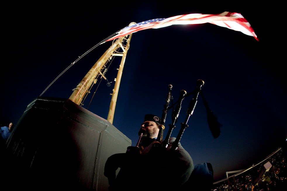 "10th Anniversary of 9/11 - Pipe Major Tyrone Heade performs on the roof of Seattle's Space Needle, 5:46 AM.  Music includes ""West & Liberty"", an original piece Tyrone was composing at the time of the attacks in 2001."